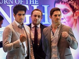 Indian boxer Vijender Singh and Australian boxer Kerry Hope (right) with Francis Warren, Promoter of Queensberry Promotions at a press conference in New Delhi