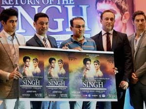Indian boxer Vijender Singh (L) and Australian boxer Kerry Hope (right) with Francis Warren, Promoter of Queensberry Promotions (second right), former cricketer Virendra Sehwag (centre) and Neerav To