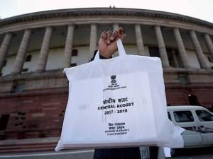 An official showing the copy of Union Budget 2017-18 at Parliament after its presentation in the Lok Sabha in New Delhi