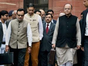 Finance Minister Arun Jaitley and Revenue Secretary Hasmukh Adhia  outside the North Block before presenting the Union Budget for 2017 in the Parliament