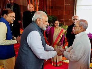 President Pranab Mukherjee being received by Vice President Hamid Ansari and Prime Minister Narendra Modi ahead of his address to the joint session of Parliament on the first day of Budget session