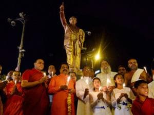 Buddhist monks with all regions priests paying candle light tribute to B R Ambedkar on the eve of his 125th birth anniversary, in Bhopal.