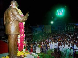 People take part in Buddha Vandana programme organised on the occasion of 125th birth anniversary of BR Ambedkar in Karad, Maharashtra.