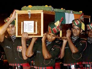 Army jawans carry the body of Sep B Ghorai who was killed in Uri attack
