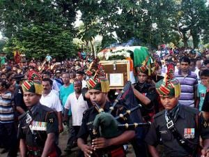 Army jawans carry the coffin of Sepoy Gangadhar Dolui