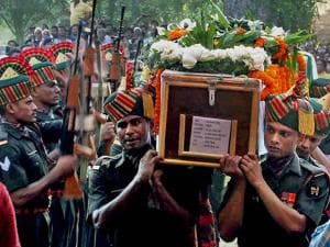 Army jawans carry the coffin of Sepoy Gangadhar Dolui, who was martyred in Uri attack