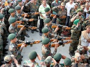 Army jawans paying gun salute during the funeral of Havildar Ravi Paul at his native village
