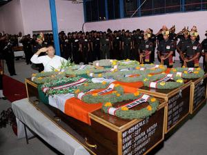 Jharkhand Governor Droupadi Murmu offering tribute to slain Army jawans Jawra Munda, Nayan Kumar  and S K Vidyarthi in Ranchi