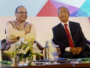 Union Finance Minister, Arun Jaitley with SEBI Chairman, U K Sinha during a conference ahead of BRICS Summit