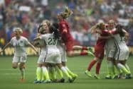 United States players celebrate after they defeated Japan 5-2 in the FIFA Women's World Cup