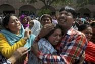 Pakistan's minority Christians buried the victims of Sunday's suicide attacks