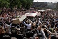 Pakistani Christians carry a casket of the victim of Sunday's pair of suicide attacks