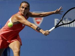 Roberta Vinci of Italy, returns a shot to Kristina Mladenovic of France