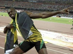 Jamaica's Usain Bolt celebrates after winning the gold medal