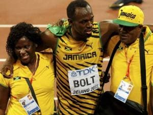 Jamaica's Usain Bolt celebrates with his mother Jennifer Bolt and his father Wellesley Bolt