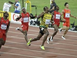 Jamaica's Usain Bolt  wins the gold medal in the men's 100m ahead of United States' Justin Gatlin