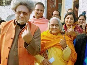 Gayatri Parivar's  Pranav Pandya showing inked finger with his wife after voting in Haridwar