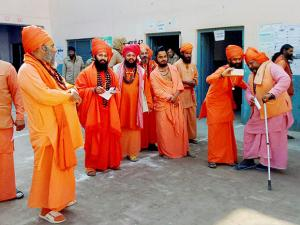 Sadhus gather at polling stations to cast their vote for the assembly election in Haridwar