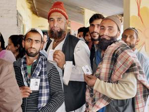 Voters waiting in line to cast their vote during  Uttarakhand assembly election in Haridwar