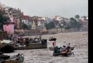 People travelling by boats at a Ghat in Varanasi