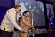 Gujarat Chief Minister Anandiben Patel and  the State Minister Finance Saurabh Patel lighting the lamp