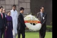 Vietnam Prime Minister Nguyen Tan Dung with  his wife Tran Thanh Kiem arrive for  paying tribute at the memorial of Mahatma Gandhi at Rajghat