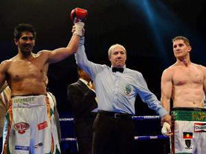 boxer Vijender Singh celebrates  after beating Australia's  Kerry Hope and won the WBO Asia Pacific Super Middleweight Championship