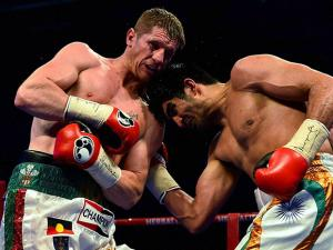 Vijender Singh hits his  opponent Australia's  Kerry Hope