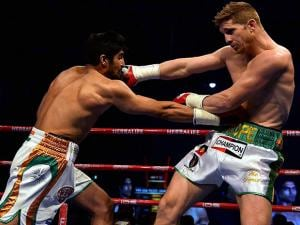 Vijender Singh hits his  opponent Australia's  Kerry Hope during the WBO Asia Pacific Middleweight Championship