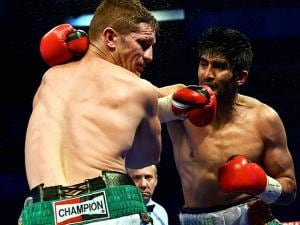Vijender Singh hits  Kerry Hope during Boxing match