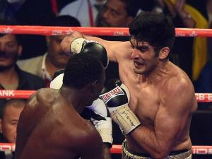 Vijender Singh fights with Francis Cheka  of Tanzania during the  Proboxing  match  in New Delhi