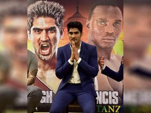 Indian boxing star Vijender Singh during a news conference with Francis Cheka