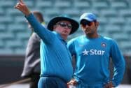 India's cricket captain MS Dhoni, right, talks with head coach Duncan Fletcher