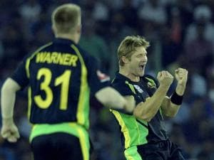 Australian bolwer Shane Watson celebrates after taking wicket of Indian batsman Suresh Raina during the ICC World T20 match at PCA cricket stadium in Mohali