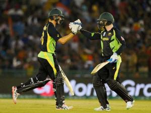 Australian players Watson and Peter Nevill during their World Cup T20 match against India at PCA Cricket Stadium, Mohali