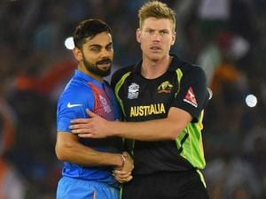 Indian batsman Virat Kohli greeted by Australia's James Faulkner after winning the ICC World T20 match against Australia at PCA cricket stadium in Mohali