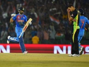 Indian batsman Virat Kohli runs during the ICC World T20 match against Australia at PCA cricket stadium in Mohali