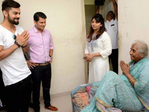 Cricketer Virat Kohli interacts with a resident of Aabhalmaya Old Age Home during a visit, in Pune