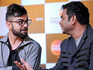 Cricketer Virat Kohli and music composer A R Rahman who will compose the official anthem of the Premier Futsal League, in Madras (2)