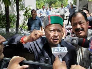 Chief Minister Virbhadra Singh arrives to appear before the Enforcement Directorate (ED) in New Delhi