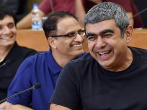 Infosys CEO Vishal Sikka with COO Pravin Rao (C) and CFO Ranganath during a press conference