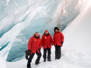 Vladimir Putin pose for a photo as they inspect a cavity in a glacier on the Arctic Franz Josef Land archipelago in Arctic Russia