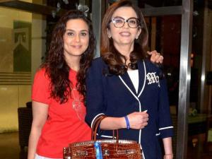 Mumbai Indians owner Neeta Ambani and Kings XI Punjab co-owner Priety Zinta arrive at a press conference