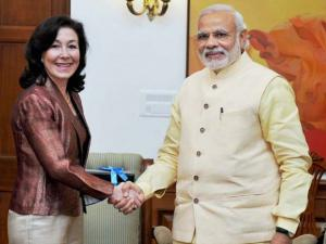 Prime Minister Narendra Modi shakes hands with  Oracle Global CEO Safra Catz during a meeting in New Delhi