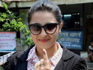 Assamese actress Nishita Goswami  showing her ink marked finger after casting vote during the 2nd phase of Assembly elections in Guwahati.