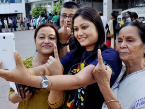 Voters taking selifie after casting votes during the 2nd phase of state assembly elections in Guwahati.