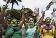Trinamool Congress activists celebrate their win in the Kolkata Municipal Corporation Elections
