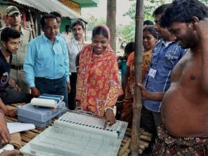 Election Commission officials demonstrating the working of Election Voting Machine (EVM) to voters during a voting awareness programme for upcoming assembly elections in Murshidabad .