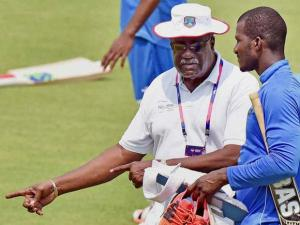 West Indies captain Darren Sammy with Clive Lloyd during a practice session at the Eden Gardens