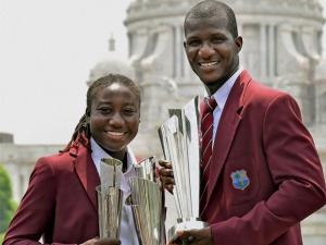 West Indies Captain Darren Sammy and Women Team Captain Stafanie Taylor poses with their respective ICC T20 World Cup Trophies in front of Victoria Memorial in Kolkata